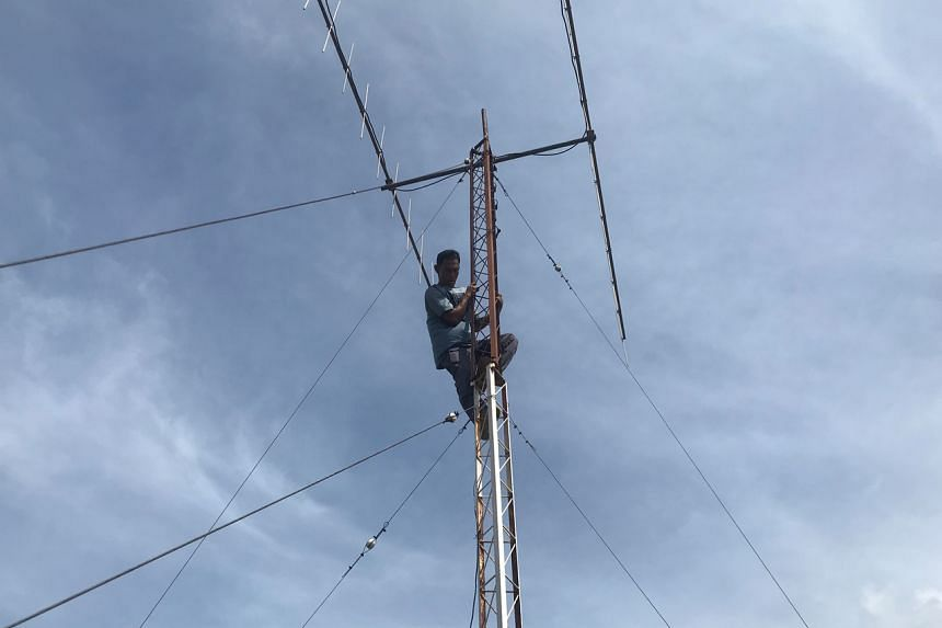 Mr Arif Munandar, a radio communication technician at Aceh's disaster mitigation agency, checks a tower in Banda Aceh, Indonesia, on Dec 13, 2019.