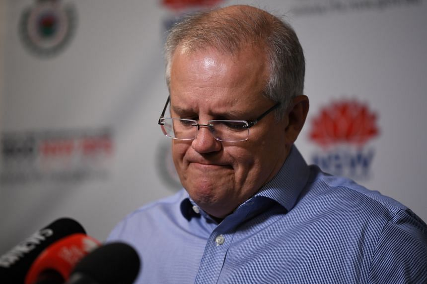 Australian Prime Minister Scott Morrison speaks to the media after touring the New South Wales Rural Fire Service  control room in Sydney on Dec 22, 2019.
