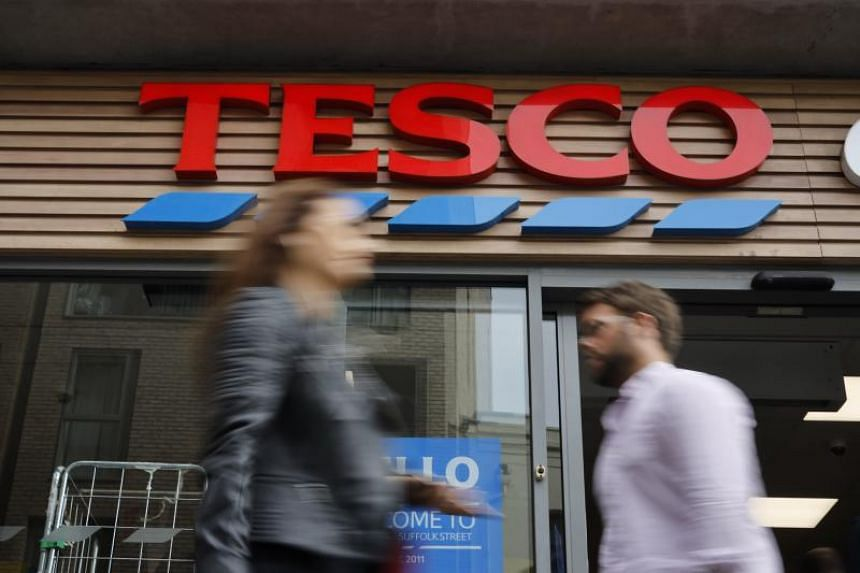 British supermarket giant Tesco suspended a Chinese supplier of Christmas cards after a customer found a message written inside a card that said it had been packed by foreign prisoners who were victims of forced labour.