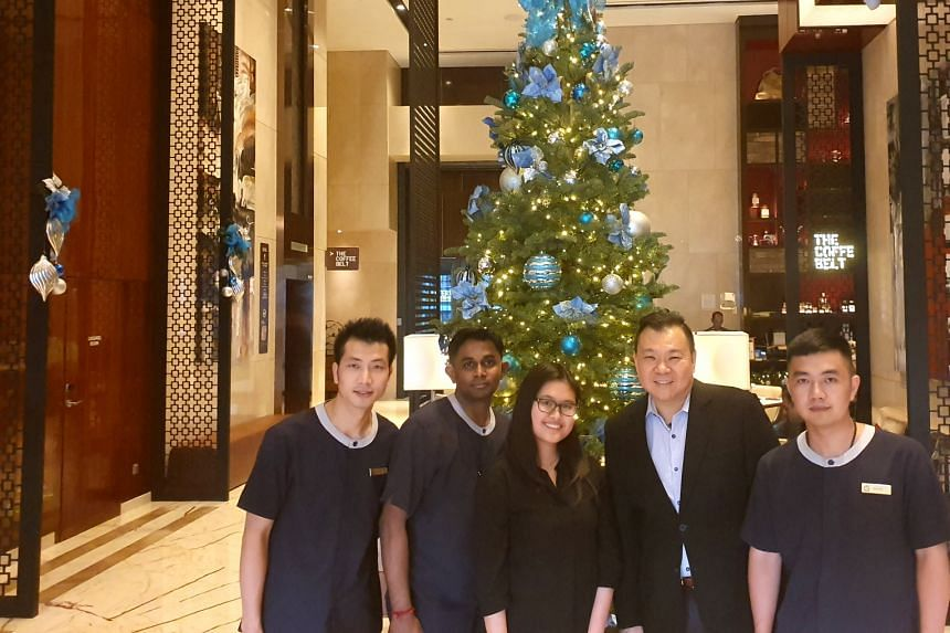 Ms Shirley Goh (third from left) with her housekeeping superiors from Park Hotel Farrer Park. PHOTO: SHIRLEY GOH