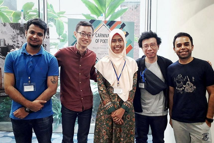 Panellists at the Migrant Literature Festival at the National Library yesterday. (From left) Winner of the 2016 Migrant Worker Poetry Competition Bikas Nath from Bangladesh, moderator Theophilus Kwek, Indonesian poet Yulia Endang, publisher Kenny Lec