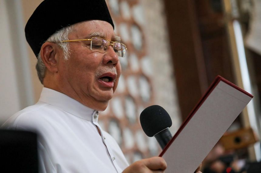 Former Malaysian prime minister Najib Razak takes an Islamic oath to deny allegations that he had ordered the murder of Mongolian Altantuya Shaariibuu, at a mosque in Kuala Lumpur, on Dec 20, 2019.