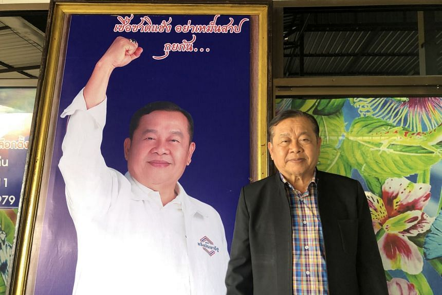 Somsak Khun-ngern takes a photo with his campaign poster at Palang Pracharath Party office in Nong Ruea district, Khon Kaen province, Thailand.