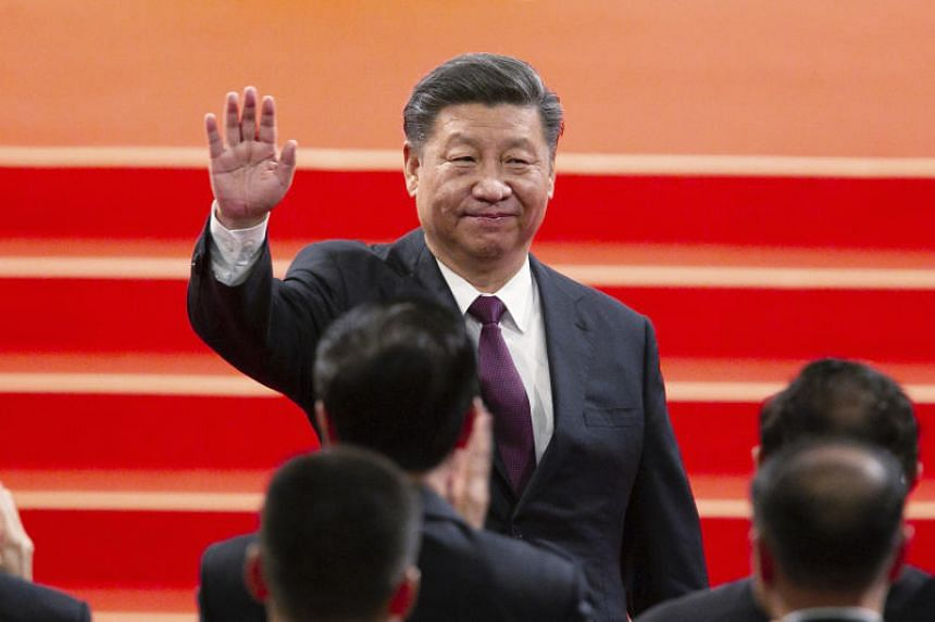 Chinese President Xi Jinping waves during the inauguration ceremony in Macau on Dec 20, 2019.