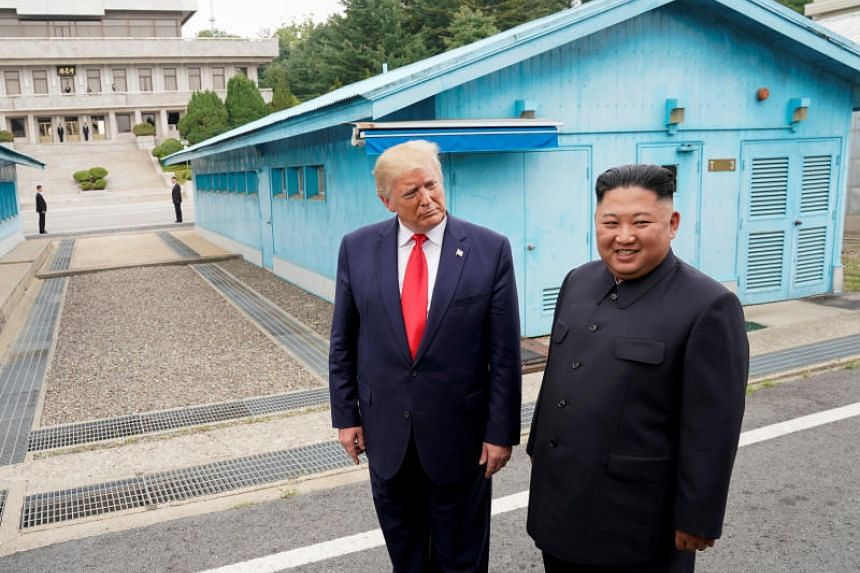 This photo taken on June 30, 2019, US President Donald Trump meets with North Korean leader Kim Jong Un at the demilitarised zone in Panmunjom, South Korea.