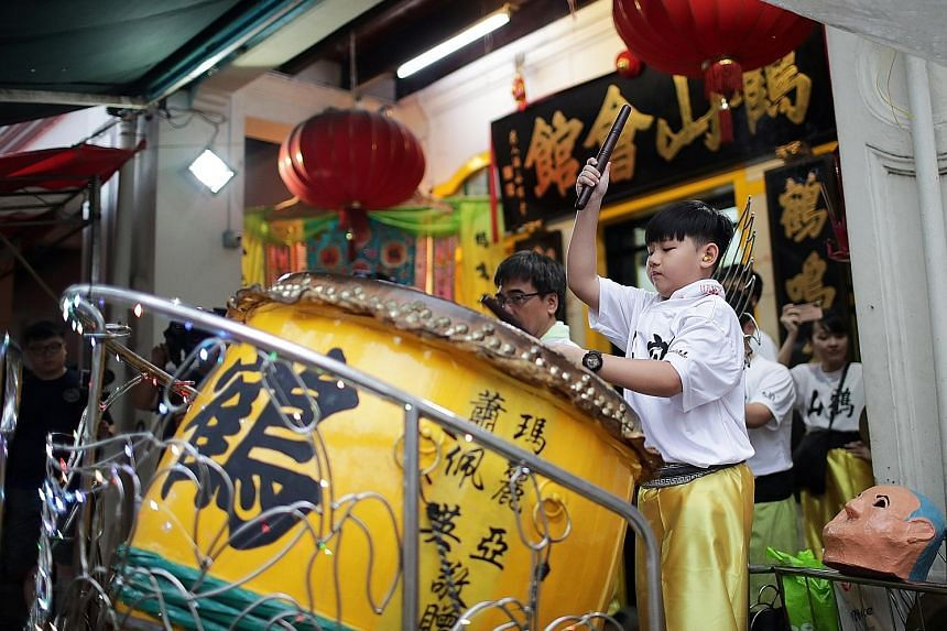 Student Keith Kok, 11, playing the drum during a lion dance performance by the Singapore Hok San Association earlier this month.