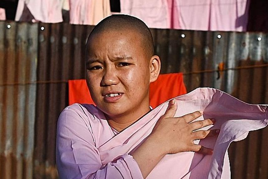 Buddhist nuns from the Mingalar Thaikti nunnery collecting alms in Yangon. All of the nunnery's 66 girls were born in an area of Shan state plagued by conflict between local rebel groups and the military. Teenager Dhama Theingi said her parents sent