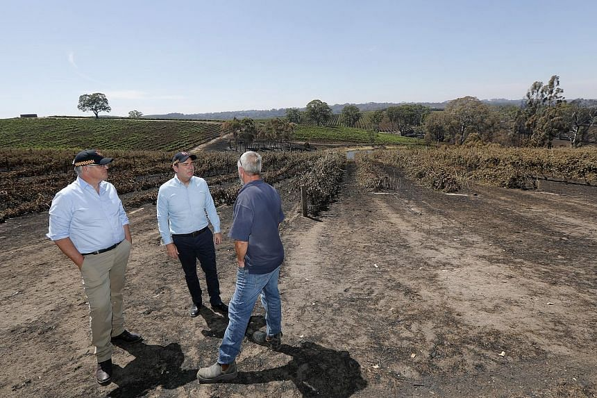 From left Australian Prime Minister Scott Morrison South Australia Premier Steven Marshall and the owner of a property destroyed by bush fire on the man's land yesterday. The unprecedented bush fires devastating swathes of Australia have already