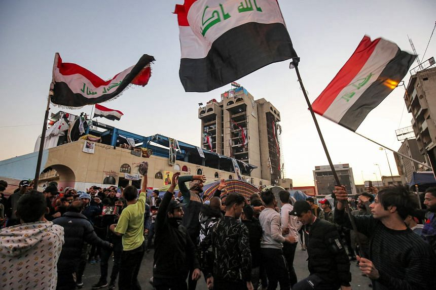 Iraqi anti-government protesters at Tahrir Square in Tehran on Dec 24, 2019, after Parliament approved a new election law.