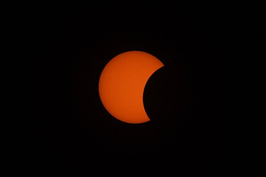 """The Moon starts to move in front of the Sun in a rare """"ring of fire"""" solar eclipse, as seen from Wan Twin in central Myanmar, on Dec 26, 2019."""