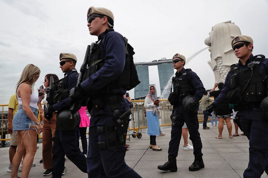 In a photo taken on Dec 27, 2018, police officers are seen patrolling the Merlion Park.