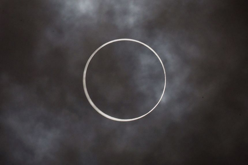 The annular solar eclipse at 1.22pm, seen through the clouds.
