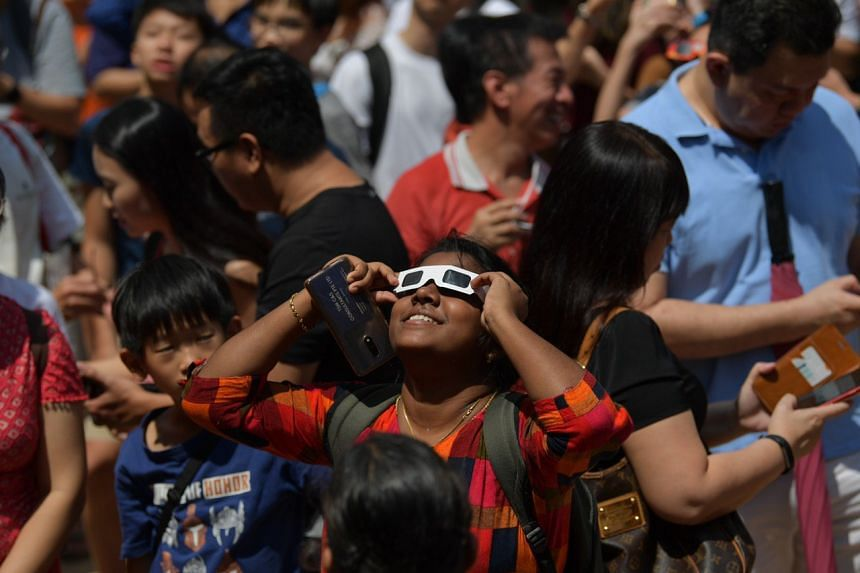 About 800 people gathered at the amphitheatre in front of Block 134 Ang Mo Kio Avenue 3 to view the annular eclipse on Dec 26, 2019.