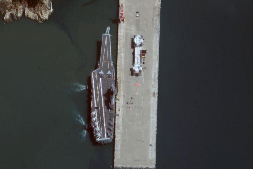 A photo taken on Nov 19, 2019, shows Chinese aircraft carrier Shandongn at Yulin Naval Base on China's Hainan Island.