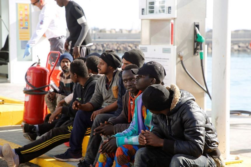 Part of a group of 30 migrants rest after being rescued in Melilla, southern Spain, on Dec 26, 2019.