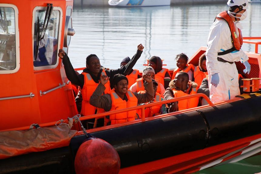 A Spanish sea rescue ship arrives ashore carrying rescued migrants in Melilla, southern Spain.