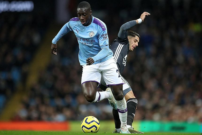 Manchester City defender Benjamin Mendy driving past Leicester City's Ayoze Perez during City's 3-1 Premier League win on Saturday. PHOTO: REUTERS