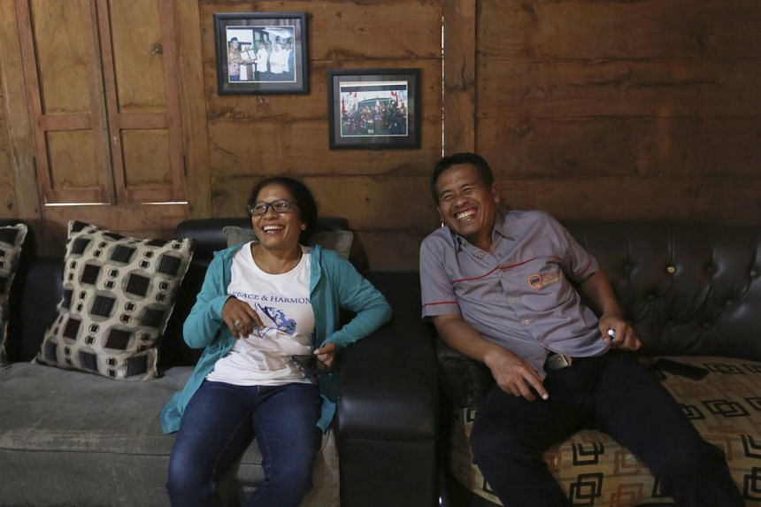 Ms Ni Luh Erniati, whose husband died in the 2002 Bali attack, with former bombmaker Ali Fauzi at his house in Indonesia on April 27, 2019. The Alliance for a Peaceful Indonesia has reconciled 49 victims and six former extremists since 2013.