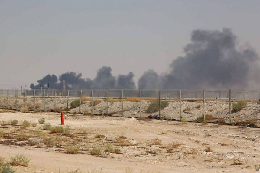 Smoke billows from an Aramco oil facility in Abqaiq about 60km south-west of Dhahran in Saudi Arabia's eastern province, on Sept 14, 2019.