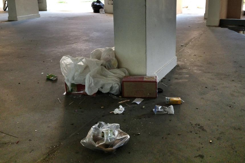 Litter on the floor of the void deck at Block 205 Toa Payoh North.