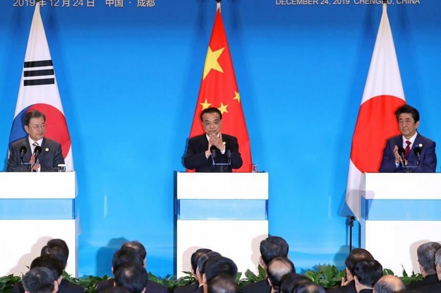 (From left) South Korean President Moon Jae-in, Chinese Premier Li Keqiang and Japanese Prime Minister Shinzo Abe attending a press conference after a summit in Chengdu, China, on Dec 24, 2019.