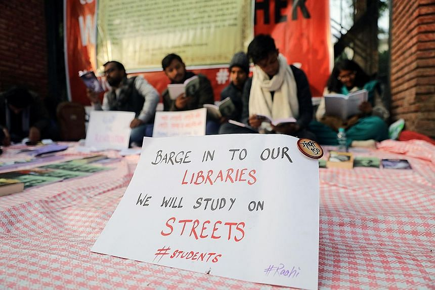 Students outside the Jamia Millia Islamia University in New Delhi protesting against India's new controversial citizenship law on Thursday. PHOTO: REUTERS