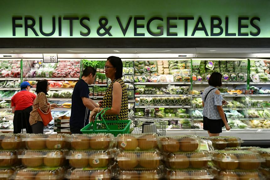 Shoppers at a supermarket in Serangoon, on March 23, 2017.