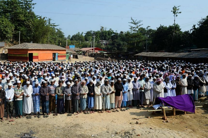 Rohingya men offering prayers during a funeral at Hakimpara refugee camp in Ukhia, on Dec 9, 2019.
