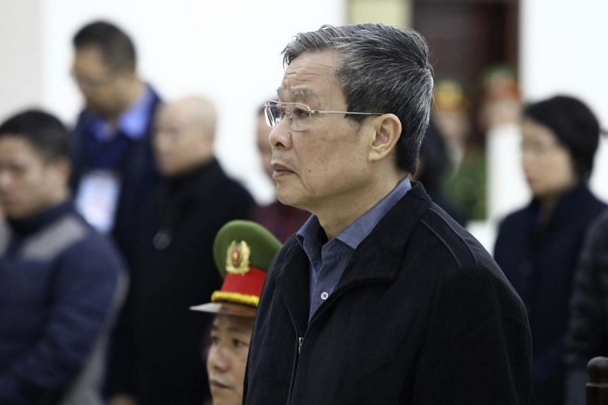 Vietnamese former minister of information and communication Nguyen Bac Son stands as a judge reads the verdicts at his trial in Vietnam on Dec 28, 2019.