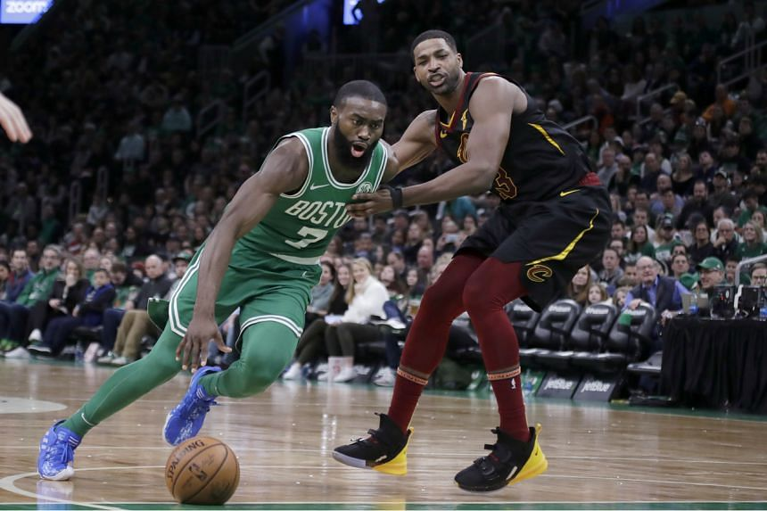The Boston Celtics' Jaylen Brown drives against the Cleveland Cavaliers' Tristan Thompson during their NBA game.