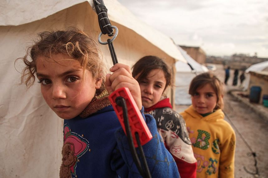 Syrian children at a camp for displaced people near the border with Turkey, on Dec 27, 2019.