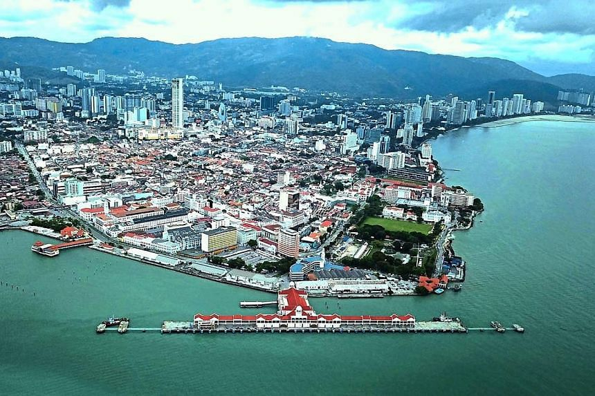 Penang's Eastern Seafront Development project will include expanding the cruise terminal of Swettenham Pier (above), developing the Tanjung City Marina, and building the Promenade Walk along the waterfront. PHOTO: THE STAR/ASIA NEWS NETWORK
