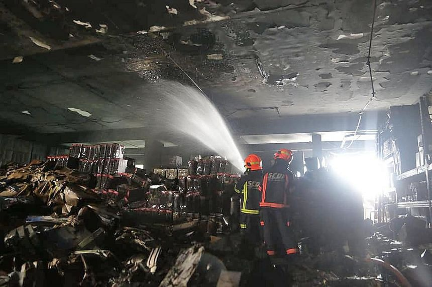 The Singapore Civil Defence Force said yesterday's fire, which broke out at an industrial building at 8 Tagore Drive, involved several items of combustible materials, such as household items and electronic products, in carton boxes.
