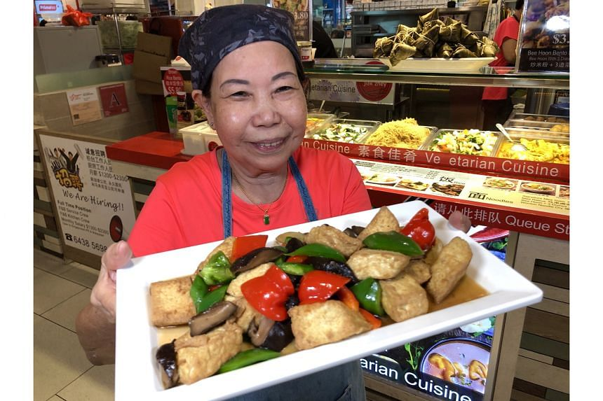 Madam Heng Chen Kiow, owner and chef of Jiak Zhey Vegetarian Food, makes her own beancurd for dishes such as Braised Egg Tofu.