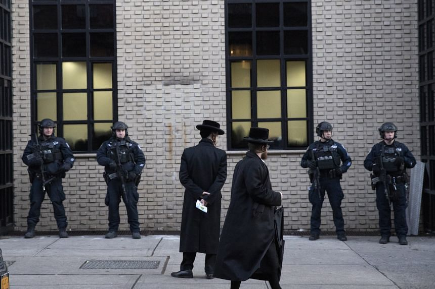 In this file photo, New York City police guard a Brooklyn synagogue on Dec 11, 2019.