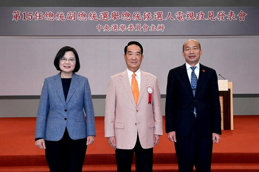(From left) Taiwan's presidential election candidates Tsai Ing-wen, James Soong Chu-yu and Han Kuo-yu pose for photographs before the first televised election debate in Taipei on Dec 18, 2019.