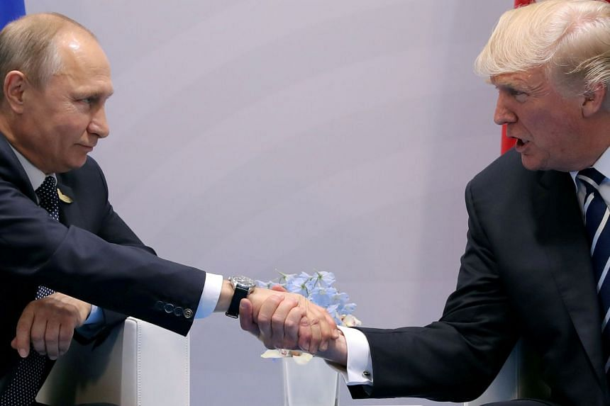 Putin (left) and Trump shake hands during a meeting at the G20 summit in 2017.
