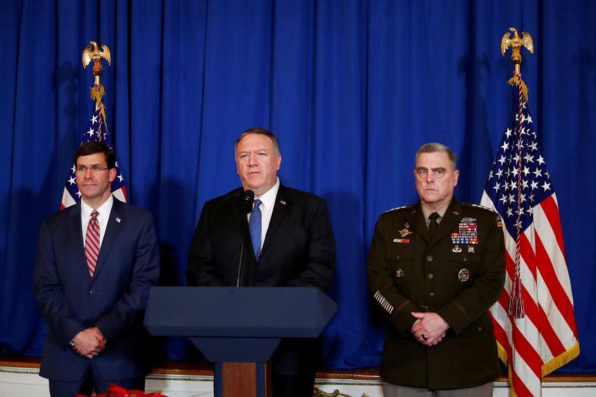 US Secretary of State Mike Pompeo, flanked by Defence Secretary Mark Esper and General Mark Milley, comments on US airstrikes in Iraq and Syria at the Mar-a-Lago club in Palm Beach, Florida, on Dec 29, 2019.