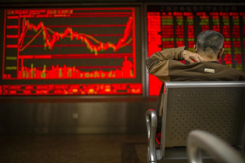 A Chinese investor monitors stock prices in Bejiing on Dec 26, 2019.