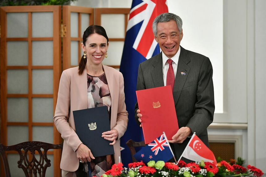 In a photo taken on May 17, 2019, New Zealand PM Jacinda Ardern and Singapore PM Lee Hsien Loong mark 54 years of diplomatic relations at the signing of the Singapore-New Zealand Enhanced Partnership.