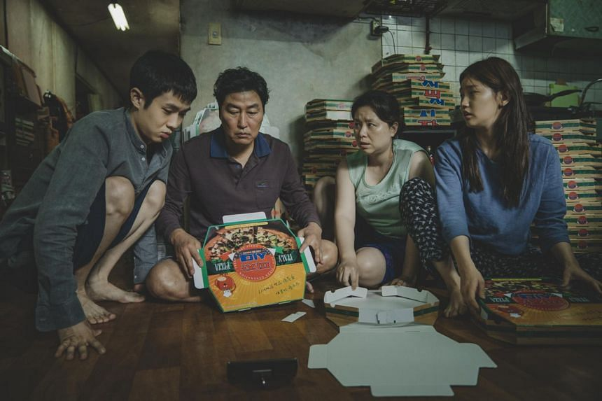 (From left) Choi Woo-sik, Song Kang-ho, Jang Hye-jin and Park So-dam in a scene from Parasite.