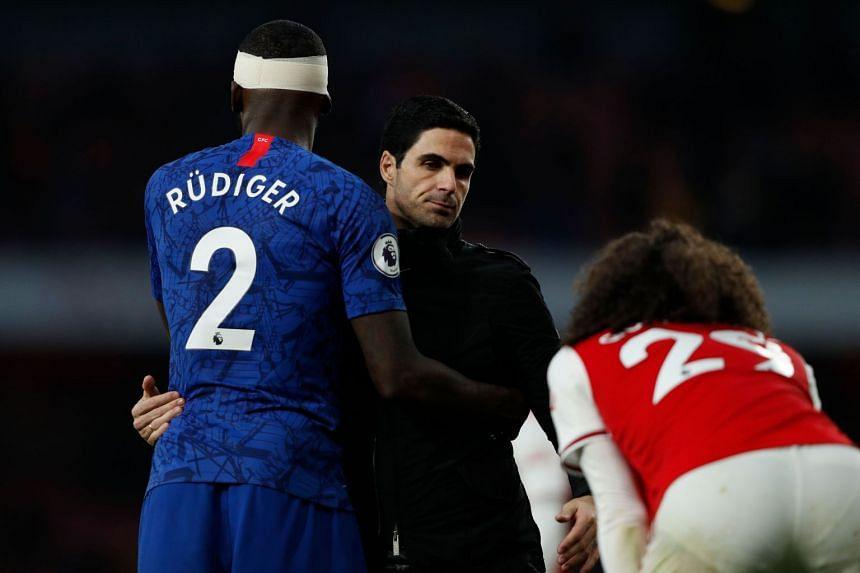 Arteta (centre) embraces Chelsea's Antonio Rudiger (left) and Arsenal's Matteo Guendouzi at the end of the match.