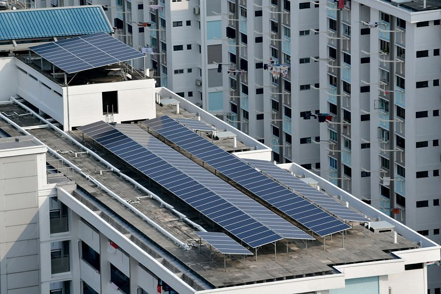 Solar panels on the rooftop of a Housing & Development Board (HDB) block in Ang Mo Kio. The HDB plans to more than double its capacity for solar power by 2030.