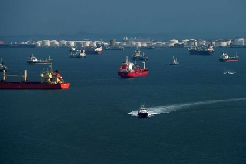 A photo taken on July 26, 2019, showing container ships moored off the Singapore Strait.