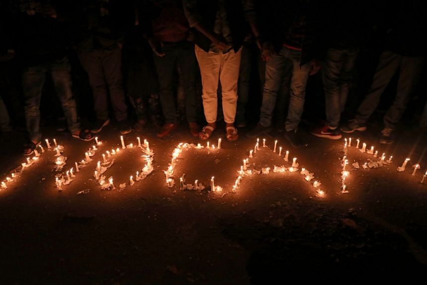 """Candles spell out """"No CAA"""" during a protest against the Citizenship Amendment Act, in New Delhi, India, on Dec 29, 2019."""