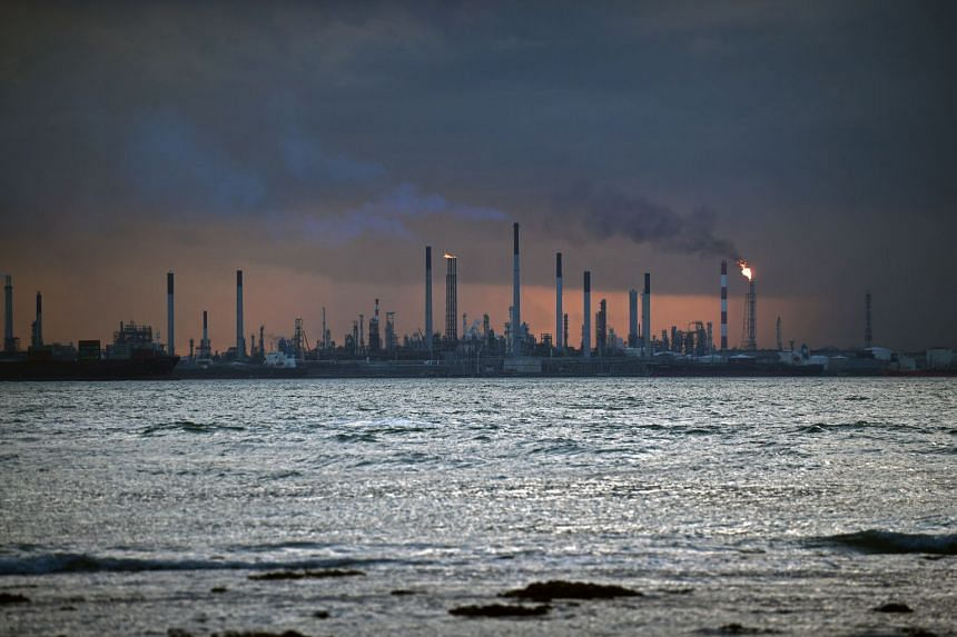 An oil refinery at Pulau Bukomon is seen from Sentosa on Feb 1, 2018.