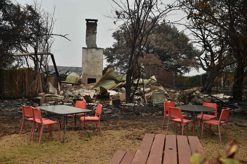 Tables and chairs are seen among debris at the Tutti Frutti cafe which was destroyed by bush fires in the town of Bilpin, 70km west of Sydney, on Dec 29, 2019.