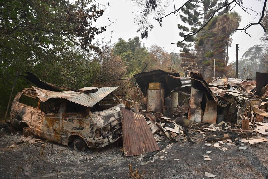 A house and van are seen destroyed after bush fires ravaged the town of Bilpin, 70km west of Sydney, on Dec 29, 2019.