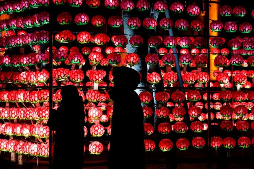 South Korean Buddhist devotees pray at the Jogyesa temple on New Year's Eve in Seoul, South Korea.