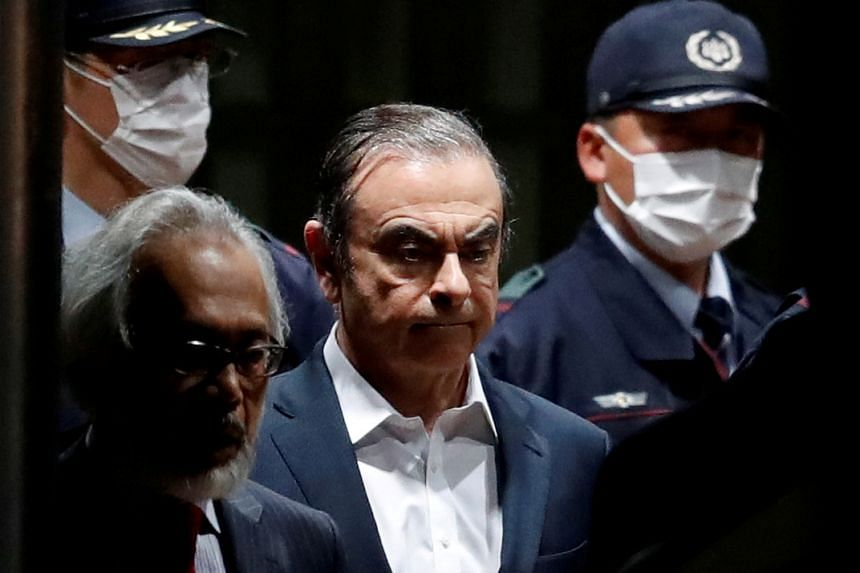 An April 2019 photo shows Carlos Ghosn leaving the Tokyo Detention House in Japan.
